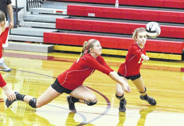 South Gallia junior Rachal Colburn, left, and sophomore Kara McCormick both dive for a dig attempt during a Sept. 6 non-conference volleyball match against Symmes Valley in Mercerville, Ohio.