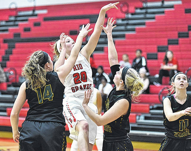 Rio Grande's Abby Wendel splits a pair of defenders to put a shot for two of her career-high 20 points in Monday night's 95-74 win over Wright State University-Lake at the Newt Oliver Arena.