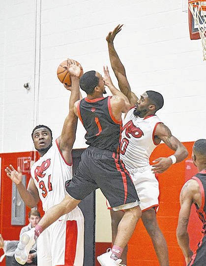 Rio Grande's Abe Eze (34) and Kenny Council (0) attempt to block the shot of Indiana University Northwest's Ronald Alexander during the first half of Saturday's men's consolation game in the Bevo Francis Tournament at the Newt Oliver Arena.