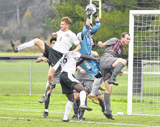 Cardinal Stritch keeper Pablo Ortiz pulls down the ball amidst a number of players from both teams in Saturday's NAIA Men's Soccer National Championship Opening Round game against the University of Rio Grande at Evan E. Davis Field.