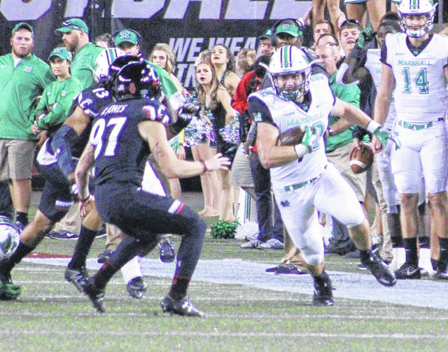 Marshall redshirt freshman Cody Mitchell, right, returns a kickoff during the second half of a Sept. 30 non-conference football contest against Cincinnati at Nippert Stadium in Cincinnati, Ohio.