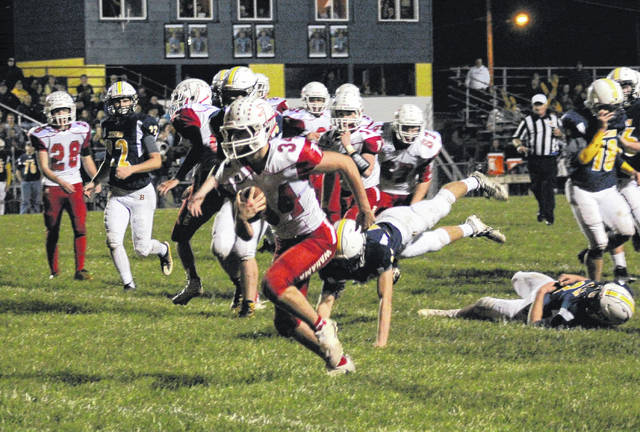Wahama's Christian Thomas breaks a 14-yard touchdown run during the second quarter of the White Falcons' season finale on Friday night in Buffalo, W.Va.