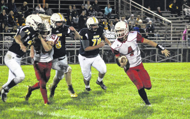 Wahama's Brady Bumgarner (4) runs behind a block from teammate Colton Arrington (28) during the White Falcons' overtime win on Friday in Buffalo, W.Va.