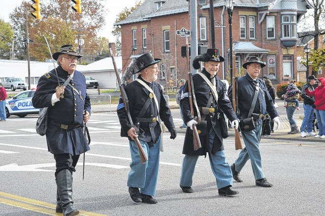 Cadot-Blessing Camp #126 Sons of Union Veterans of the Civil War follow behind VFW Post 4464 Honor Guard in traditional Union soldier uniforms.