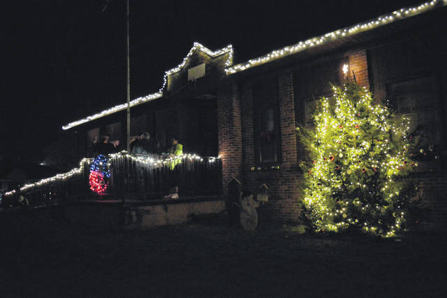 The Weatherholt family throws the switch to turn on the lights at It's a Grande Christmas in Rio Grande Thursday evening.