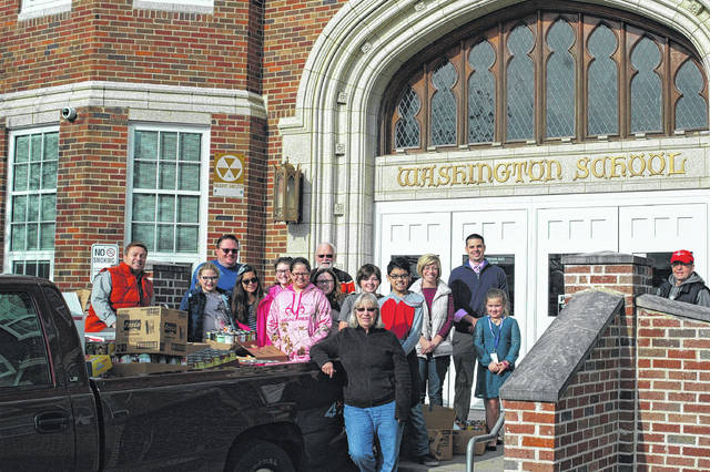 Students from Washington Elementary helped load the food they collected for Grace United Methodist Church's food pantry, which will in turn be given away to those in need.