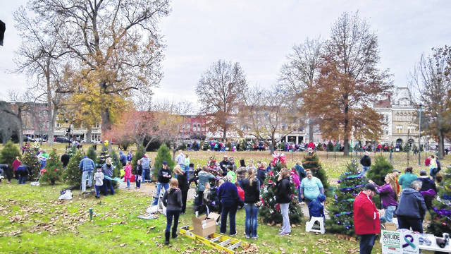 Saturday morning, community organizations met in the Gallipolis City Park to decorate their trees for the upcoming Gallipolis in Lights Season. Bob's Market and Greenhouses reportedly had over 130 trees on hand for groups to set up and decorate, of which there are numerous themes. The official park lighting will be Wednesday at 7 p.m. with festivities starting as early at 5 p.m.