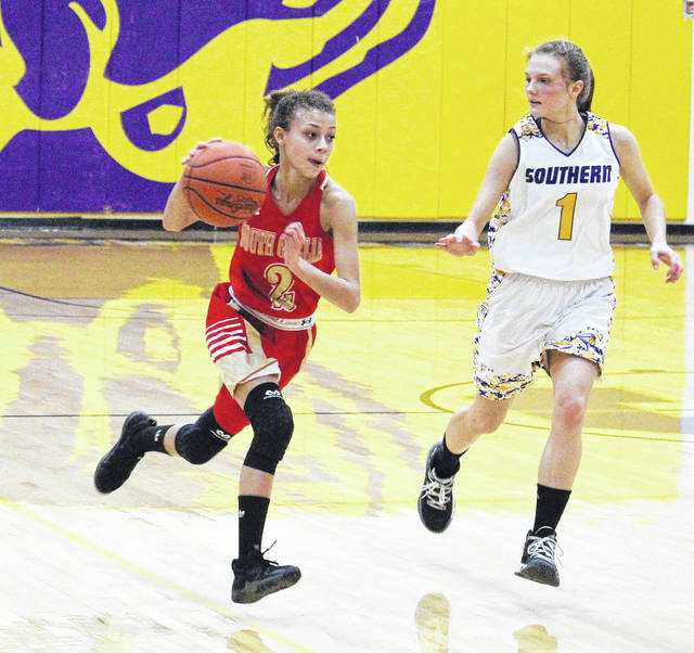 South Gallia sophomore Amaya Howell (2) drives past Southern sophomore Phoenix Cleland (1), during the Lady Rebels' 43-25 victory on Thursday in Racine, Ohio.
