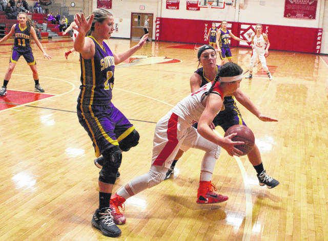 The Southern duo of Shelbi Dailey (23) and Jaiden Roberts trap Wahama's Hannah Rose during the first half of Thursday night's TVC Hocking girls basketball contest in Mason, W.Va.