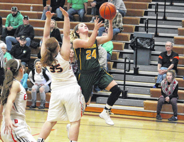 EHS junior Alyson Bailey attempts a two-pointer in front of Belpre's Kyanna Ray, during Eastern's 59-53 loss on Saturday in Belpre, Ohio.