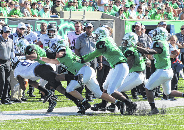 A handful of Marshall defenders push Old Dominion's Melvin Vaughn (9) out of bounds during the first quarter of a Nov. 14 Conference USA football game at Joan C. Edwards Stadium in Huntington, W.Va.