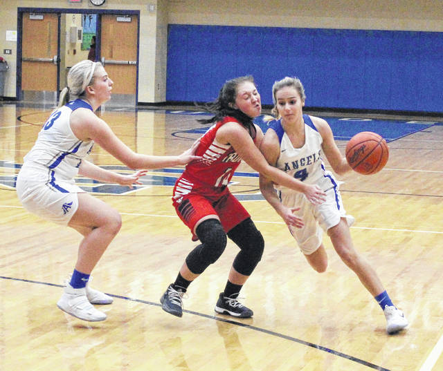 Gallia Academy sophomore Alex Barnes, right, dribbles past Jackson defender Mariah Ridgeway during the first half of Monday night's non-conference girls basketball contest in Centenary, Ohio.