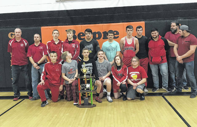 Members of the Wahama wrestling team pose for a picture after winning the first-ever Battle of the Birds tri-match held Wednesday night at Belpre High School in Belpre, Ohio.