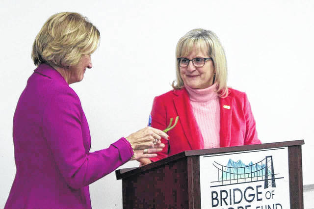 U.S. Senator Shelly Moore Capito greets Lynne Fruth, president of Fruth Pharmacy, as she comes to the lectern to speak at an event announcing the Fruth Bridge of Hope Fund.