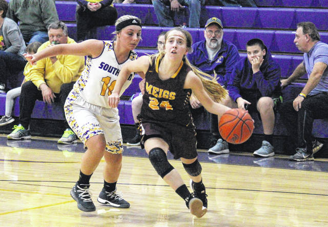 Meigs junior Madison Fields (24) drives past Southern senior Jaiden Roberts (10) during the Lady Marauders' 57-24 win on Thursday night in Racine, Ohio.