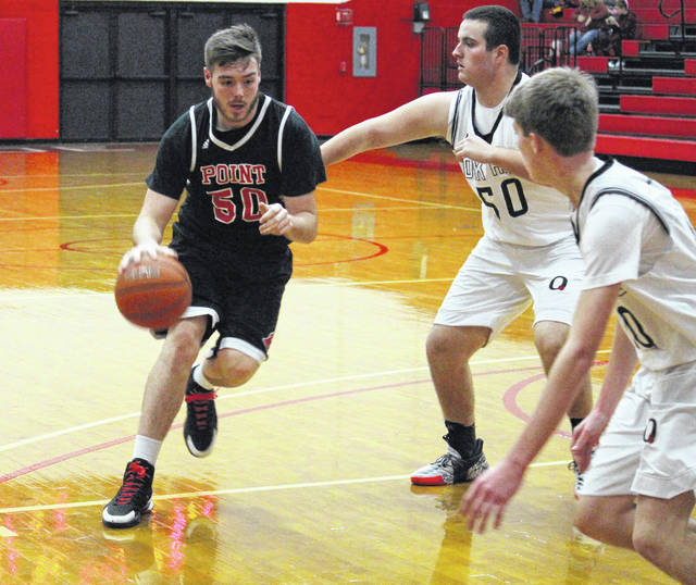 Point Pleasant senior Trace Derenberger (50) drives past an Oak Hill defender during a Dec. 9 boys basketball contest at the University of Rio Grande Lyne Center in Rio Grande, Ohio.