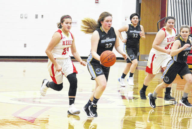 OVCS junior Emily Childers (33) leads SGHS freshman Makayla Waugh (left) on a fast break, during South Gallia's 50-17 victory on Friday in Mercerville, Ohio.