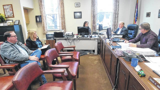 New Ohio Department of Transportation District 10 Deputy Director Darla Miller, upper left, addresses the Gallia Commissioners Thursday with Jackson Pike ODOT Transportation Administrator Mark Kirkhart, lower left. Gallia Commissioners Harold Montgomery, upper right, and Brent Saunders, lower right, share concerns with upcoming county sewer renovations. Not pictured, Commissioner David Smith.