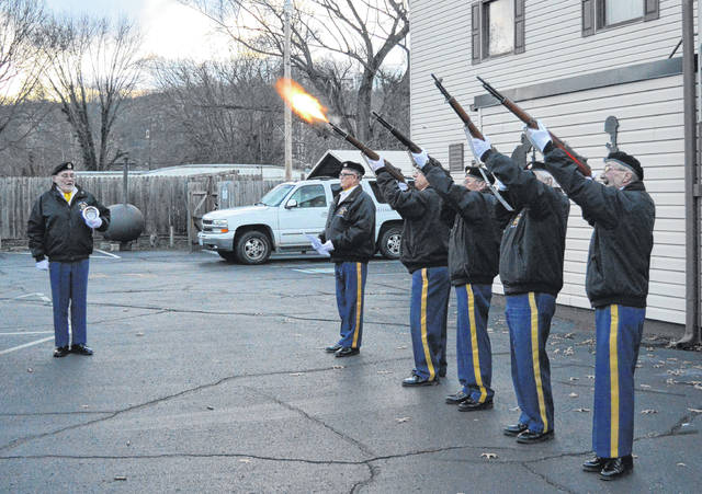 "VFW Post 4464 Honor Guard holds a firing salute and reading Thursday in memory of those lost during the Pearl Harbor attacks which occurred December 7, 1941. From left to right stand Commander Bill Mangus, John Watson, Charlie Huber, Carroll Taylor, Henry Maynard and Jerry Baker. Watson read a poem often shared with VFW members as they remember those who have fallen titled ""Freedom isn't Free."""
