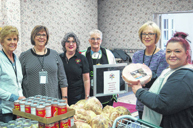 The Gallipolis Chapter of Ohio Eastern Star purchased and donated 130 hams for the holiday season. They were given out Tuesday as part of the Lutheran Social Services Food Truck at Grace United Methodist Church, which assists families throughout Gallia County. This was the first year donating hams, a tradition they hope to continue. From left: Jeanie Howell, Margi Wheeler, Gwen McGuire, Jean Henderson, and Marlene Childers.