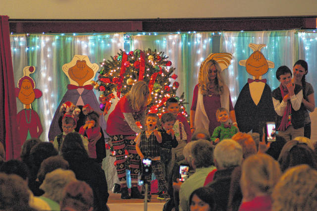 """Students at Guiding Hand School had a Whoville Christmas singing and dancing on stage singing """"Rocking Around the Christmas Tree."""""""