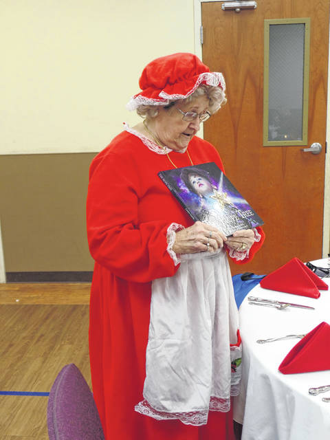 Vickie Powell reads a Christmas story as Mrs. Claus.