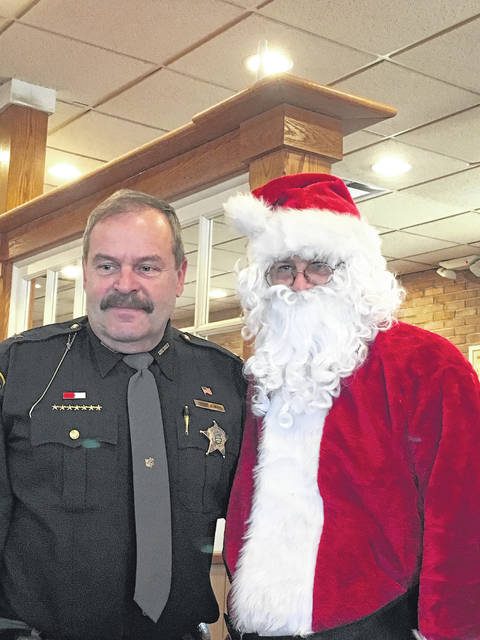 Sheriff Keith O. Wood with Santa Claus at Bob Evans.