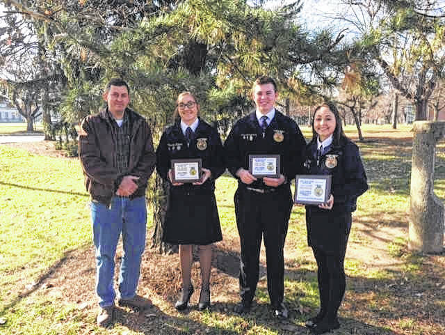 Cassidy Starnes, Clay Montgomery, and Erin Pope of the Gallipolis FFA Chapter recently competed in the State Job Interview Career Development Event held at the Ohio State University on December 2, 2017. For this CDE, students were evaluated on a personal cover letter and resume, an interview, and a follow-up letter at the conclusion of the event. Cassidy Starnes placed 7th the in the Senior division,Clay Montgomery placed 10th in the Junior division and Erin Pope placed 3rd in the Freshman division. Congratulations to all for your state performance. Pictured from left: Jerrod Ferguson, Gallipolis FFA Advisor, Cassidy Starnes, Clay Montgomery, and Erin Pope.