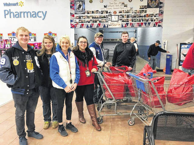 Pictured from left, Derek Henry, Isabella Bonzo, Cadha McKean, Ashleigh Miller, Jonas McCreedy, and Clay Montgomery. These GAHS FFA students went shopping for other students, buying both clothes and gifts.