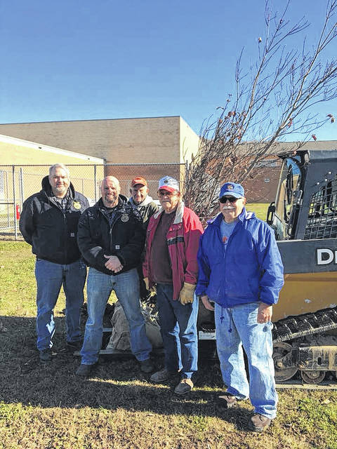 River Valley High School gladly accepted their new tree this fall. Pictured from left: Bill Holcomb and Matt Huck of River Valley, Buz Call, Richard Brown, and Rick Howell of the Gallipolis Lions Club.