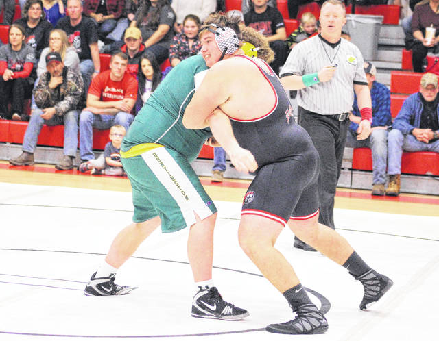 Point Pleasant sophomore Jacob Muncy maintains leverage on a Huntington opponent during a heavyweight bout against Huntington on Dec. 6, 2017, in Point Pleasant, W.Va.