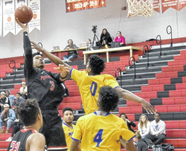 Rio Grande's Stanley Christian (3) had 17 points and 11 rebounds in Thursday night's 85-62 win over Midway University at the Newt Oliver Arena. The RedStorm snapped a three-game losing slide with the victory.