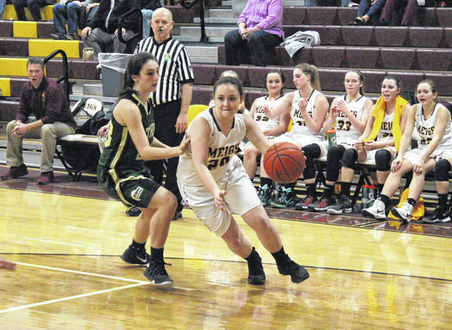 MHS junior Alyssa Smith (20) drives past Athens' Mindi Gregory, during the second half of the Lady Marauders' 61-40 victory on Monday in Rocksprings, Ohio.
