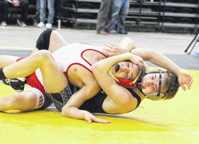 River Valley junior Jacob Edwards locks in a hold on Wahama's Ethan VanMatre during a 120-pound match Saturday at the 2018 WSAZ Invitational held at Big Sandy Superstore Arena in Huntington, W.Va.