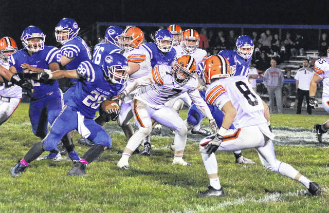 Gallia Academy junior Boo Pullins (28) picks up yardage during a second half run in a Week 9 OVC football contest against Ironton at Memorial Field in Gallipolis, Ohio.