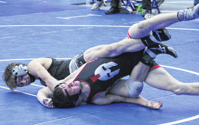 River Valley junior Jacob Edwards locks in a hold on an Alexander opponent during a 120-pound match Saturday at the 2017 Skyline Bowling Wrestling Invitational held at Gallia Academy High School in Centenary, Ohio.