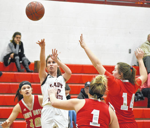 Point Pleasant junior Allison Henderson (10) attempts a shot against several Poca defenders during the first half of the Lady Knight's 57-36 loss on Tuesday night in Mason County, W.Va.
