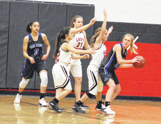 Gallia Academy junior Abby Cremeans, right, is guarded by Point Pleasant defenders Allison Henderson, Tristan Wilson and Hannah Smith during the first half of Tuesday night's non-conference girls basketball contest in Point Pleasant, W.Va.