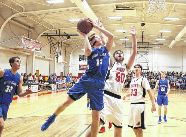 GAHS senior Kaden Thomas (12) goes in for a shot in front of PPHS senior Trace Derenberger (50) and sophomore Kade Oliver (33), during the Blue Devils' 21-point win on Saturday in Point Pleasant, W.Va.