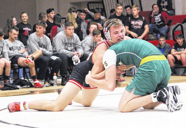 Point Pleasant senior Jacob Roub maintains leverage during a 152-pound match against Huntington during a Dec. 7, 2017, dual match in Point Pleasant, W.Va.
