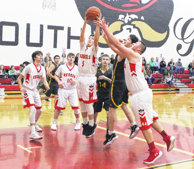 South Gallia senior Curtis Haner (5) leaps for a rebound during the first half of Tuesday night's TVC Hocking boys basketball contest against Eastern in Mercerville, Ohio.