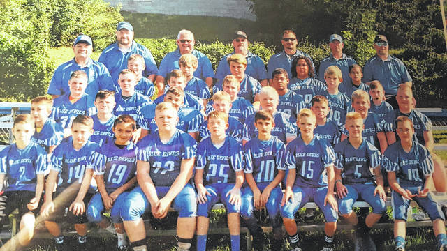 Gallipolis Elks Football A-Team. Front row from left to right, Braylon Rathburn, Hunter Peterson, Carlito Long, Dakota Siders, Isaiah Dunlap, Peyton Owens, Conner Roe, Hunter Shamblin, Tayshaun Shortridge. Second row, from left to right, Tyler Young, Hudson Shamblin, Matthew Gordon, Caleb Stout, Aiden Toler, Bradt Ducan, Nathanael Baird, Logan Siders. Third row, from left to right, Austyn Smith, Cole Hines, Matt Liberati, Brody Moore, Kenyan Franklin, William Mullins, Joey Darnbrough. Fourth row from left to right, Head Coach Mike Canaday, Cade Mock, Devin Hernandez, Nick Janes, Quinten Vanmeter, Carlos Thomas. Fifth row, from left to right, Assistant Coaches, Chris Rathburn, Buddy Moore, Jason Liberati, Chad Shamblin, Jason Rose, Tim Siders.