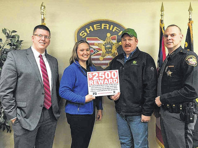 The Gallia Farm Bureau $2,500 Reward Program pays off. This Farm Bureau member benefit provided a $2,500 reward to a person in Gallia County who assisted with the conviction of a felony after a theft at Bridgeport Equipment in Gallipolis. Pictured from left are Gallia County Prosecutor Jason Holdren, Organization Director Farm Bureau Ashley Kasler, Store Manager at Bridgeport Equipment in Gallipolis David Sherman, and Gallia County Sheriff Matt Champlin.