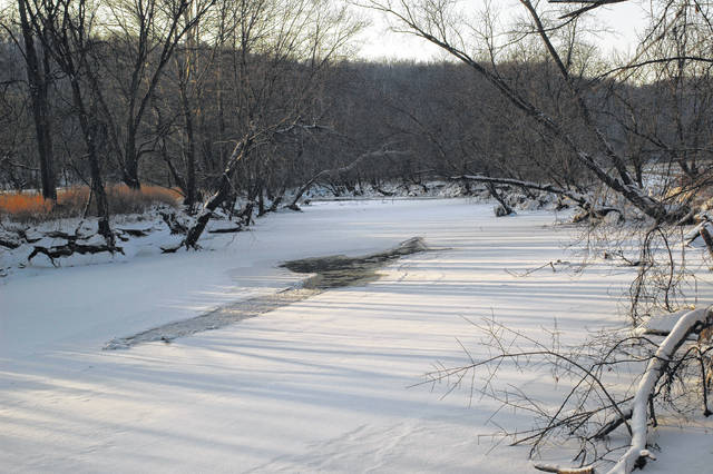 Racoon Creek in Gallia County is still frozen over in some places. As the temperature rises and the snow and ice melts, chances of flooding-related issues can arise along smaller waterways such as this.