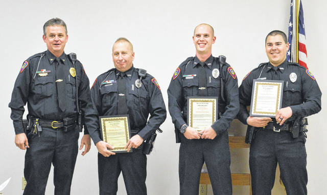 From left to right stand Gallipolis Police Chief Jeff Boyer and Gallipolis Patrolmen Scott Adkins, Shane Plantz and Gary Waldren. The three patrolmen hold their Life-Saving Awards for efforts in breathing life back into a man who had no pulse, last November.