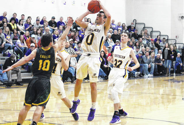 Southern senior Dylan Smith (0) attempts a two-point shot over Eastern junior Sharp Facemyer (10), during the second half of the Tornadoes' 54-44 victory on Friday in Racine, Ohio.