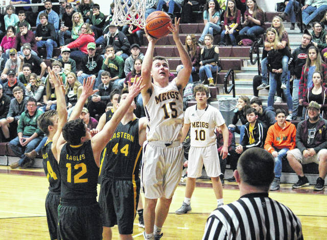 Meigs junior Zach Bartrum (15) shoots a layup in the first half of the Marauders' 57-46 victory over Eastern on Saturday in Rocksprings, Ohio.