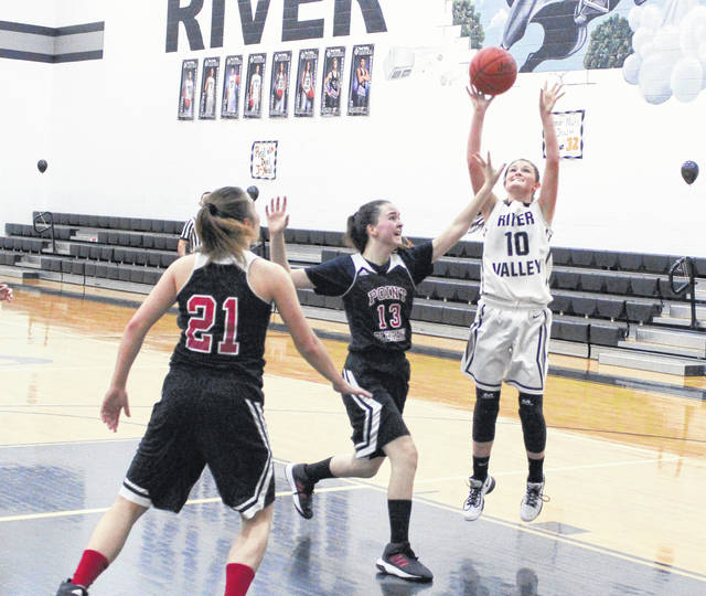 River Valley senior Jaden Neal (10) releases a shot attempt over a Point Pleasant defender during the second half of Saturday's non-conference girls basketball contest in Bidwell, Ohio.