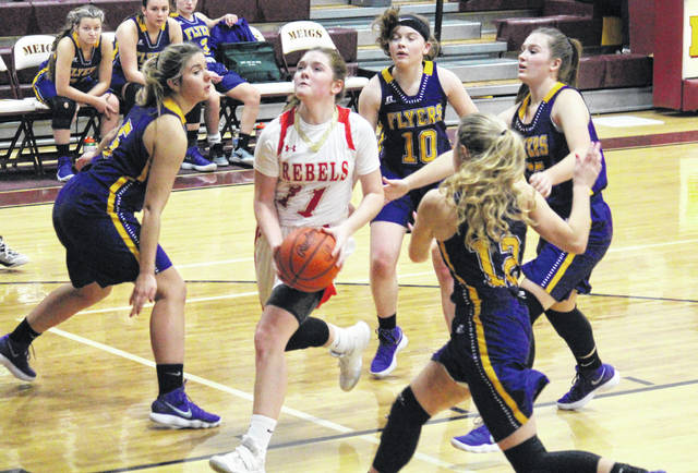 South Gallia senior Erin Evans (11) splits between a quartet of defenders during the Lady Rebels' 43-20 victory in the Division IV sectional semifinal on Monday in Rockspings, Ohio.