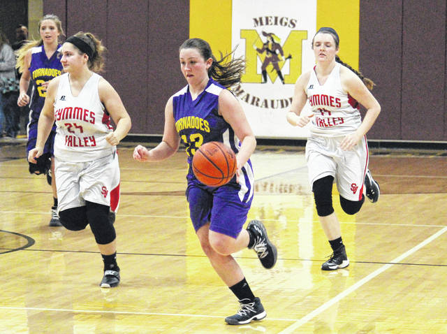 Southern senior Josie Cundiff (13) leads a fast break during the Lady Tornadoes' 60-44 loss in the Division IV sectional semifinal on Monday in Rockspings, Ohio.